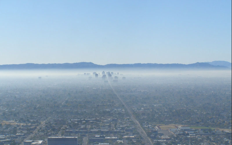 Haze surrounds the city of Phoenix and obscures the view of the skyline.