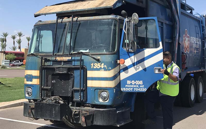 A picture of a Phoenix garbage truck.
