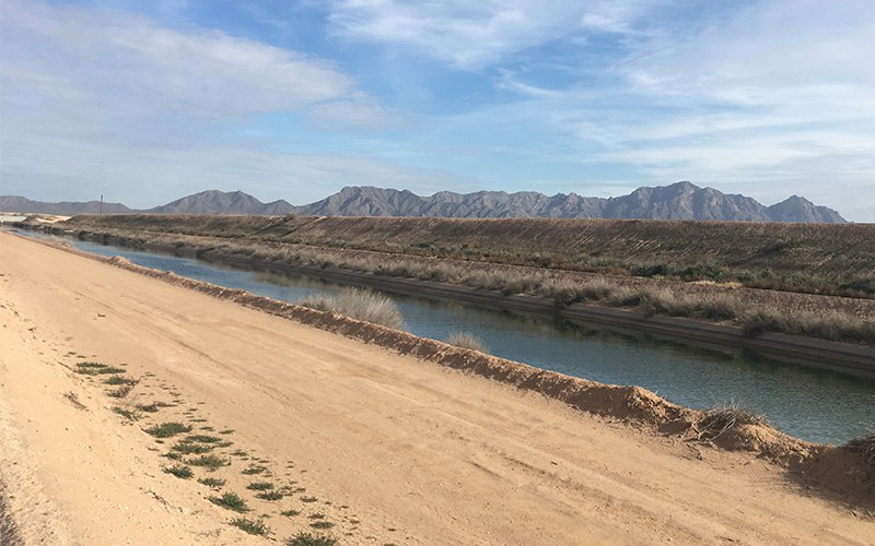A canal flowing through the desert.