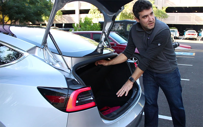 Ryan Cornell shows the trunk of a Tesla Model 3