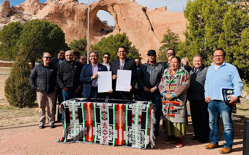 Navajo Nation Vice President Myron Lizer and President Jonathan Nez hold up the Navajo Sunrise Proclamation in Window Rock, the tribe's capital, on April 2, 2019
