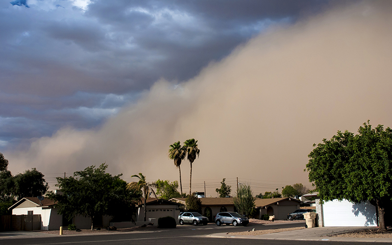 A cloud of dust known as a haboob crashes into houses in Arizona