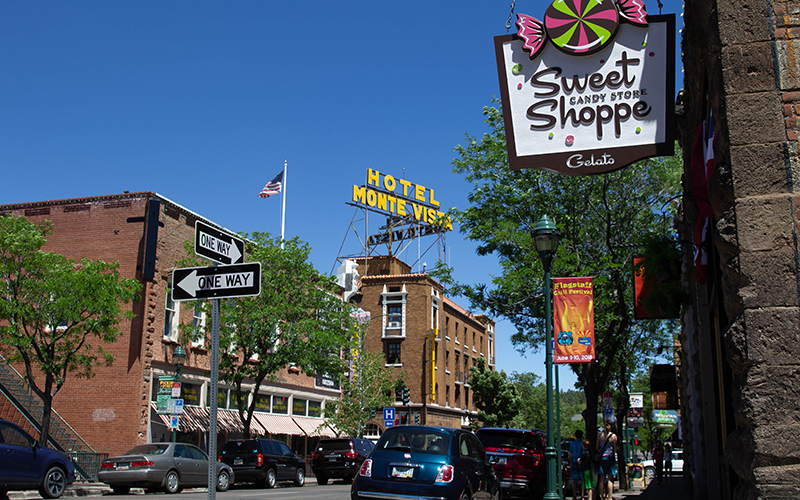 A street corner in Flagstaff in front of Sweet Shoppe Candy Store and Hotel Monte Vista