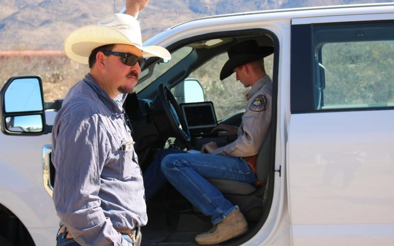 Cattle Officer Garrett Lacey prepares to inspect the livestock documents of a cattle rancher