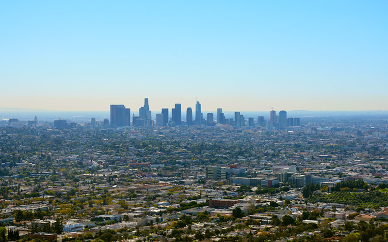 The distant Los Angeles skyline rises from an urban sprawl