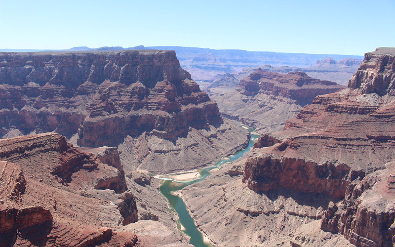 The Colorado River meanders through the Grand Canyon